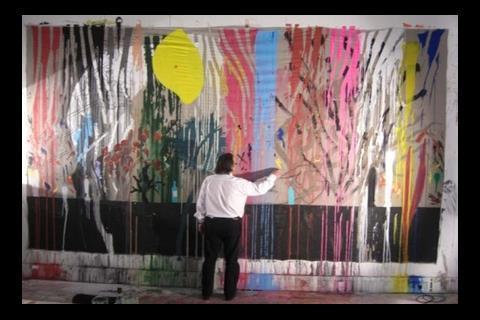 Will Alsop painting in his studio